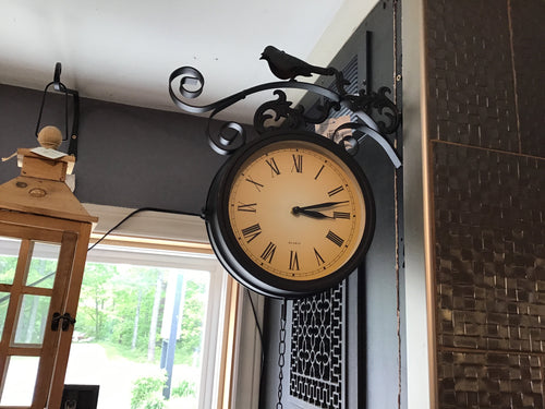 Outdoor double sided clock