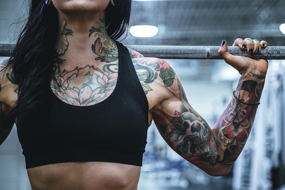 Tattoo woman at gym