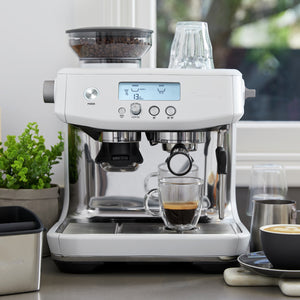 Breville Barista Pro Espresso Machine in Sea Salt White on Countertop near window