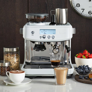 Breville Barista Pro Espresso Machine in Sea Salt White on Countertop with Lattes