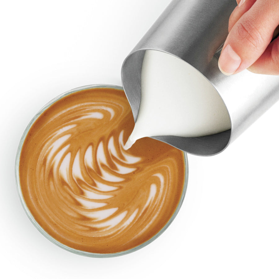 Pouring Frothed Milk from the Breville Espresso Machine into Latte Art
