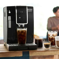 DeLonghi Dinamica Espresso Machine brewing an iced coffee