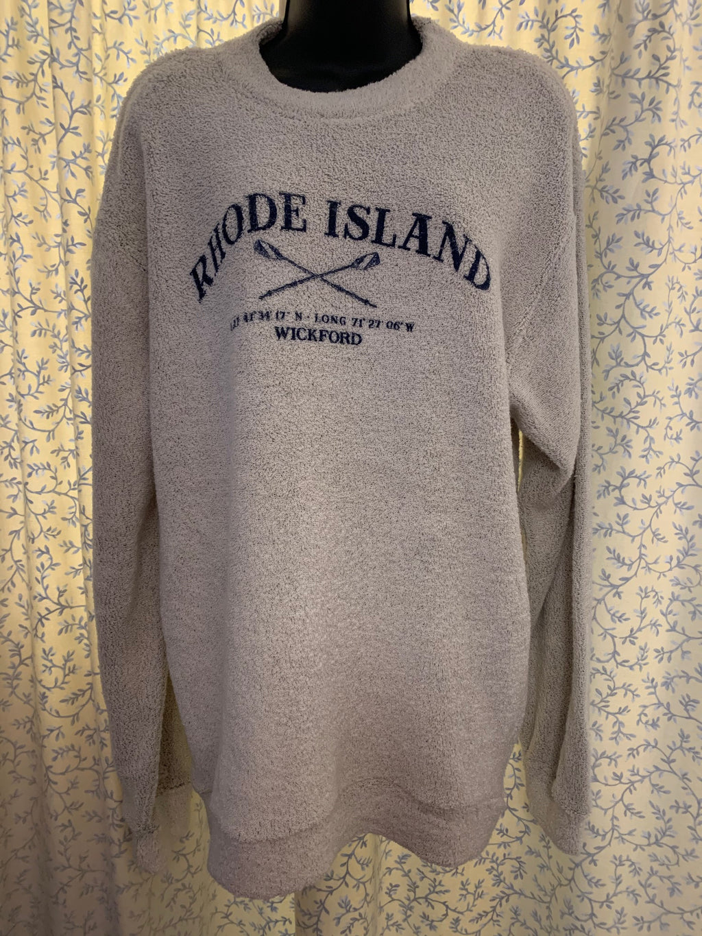"This sweatshirt is the Original Big Loop Terry Sweatshirt!  The image in navy ink reads Rhode Island, with crossed oars, Latitude is 41 degree, 34' 17"" N and Longitude is 71 degree, 27' 06"" W the last line reads Wickford.  It has a reverse construction with the terry face on the outside. Please note to wash the sweatshirt separate with like colors for the first wash as it can shed.  Sweatshirt is made by Comfort Colors and hand screen printed on Cape Cod, MA."