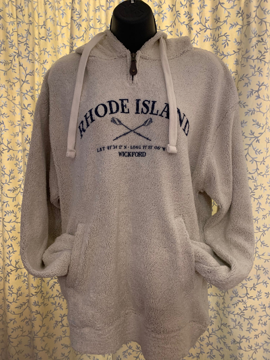 "This sweatshirt is the Original Big Loop Terry Sweatshirt!  The image in navy ink reads Rhode Island, with crossed oars, Latitude is 41 degree, 34' 17"" N and Longitude is 71 degree, 27' 06"" W the last line reads Wickford.  It has a reverse construction with the terry face on the outside. The hood is lined with jersey fabric and the drawcord is color matched. The heavy duty zipper has a fashion pull for an ease of zipping."