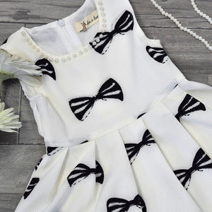 Girl Ivory Cotton Bow Print Dress, Pearl Neckline, Sleeveless