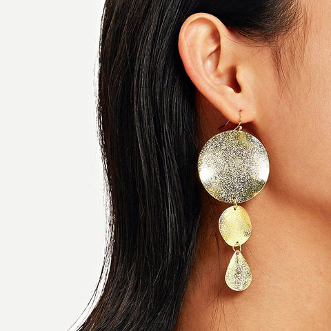 Individual wild glossy disc earrings