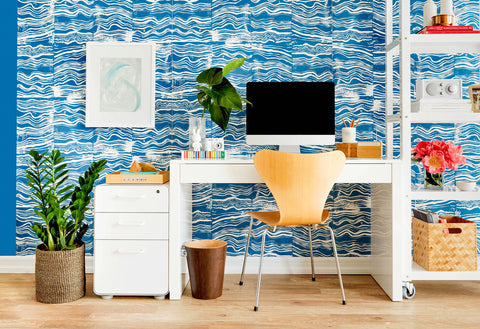 office with blue wallpaper, desk, computer and chair