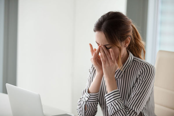 Woman experiencing anxiety in an office