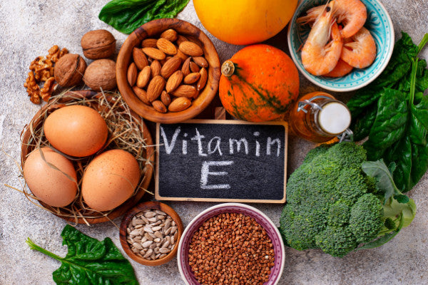 3 essential vitamins for nerve pain relief foods with vitamin e on counter broccoli eggs almonds walnuts