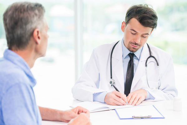 Middle-age man meeting with a doctor