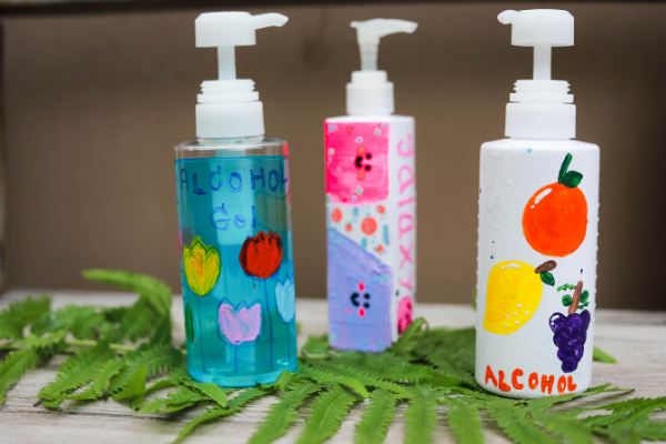 earth day reusing plastic bottles diy crafts with a plastic bottle upcycle it hand painted recycled plastic bottles turned into soap dispensers upcycle