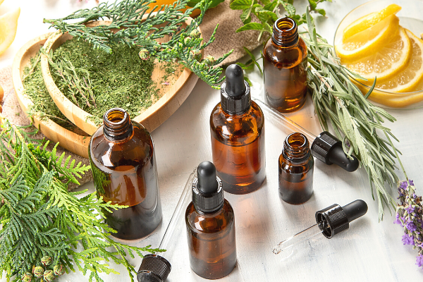 Amber glass bottles filled with essential oils and herbs