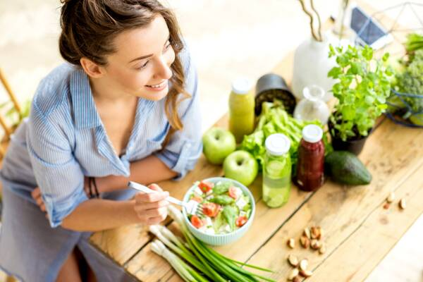 Woman eating healthy salad to boost her immune system