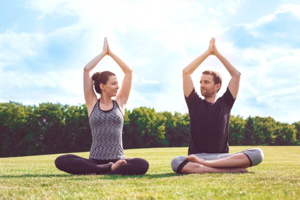 Yoga couple on lawn to boost immune system strength