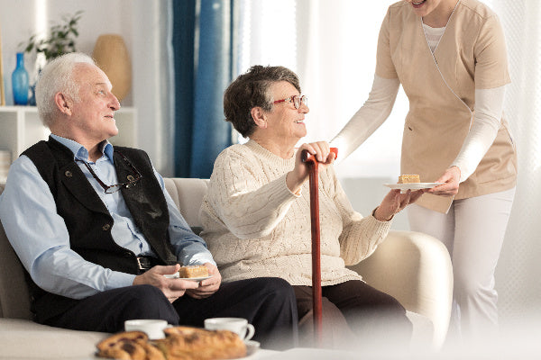 MSM for Arthritis How Does it Work What Dosage of MSM for Arthritis should you take elderly couple sitting on couch accepting refreshment