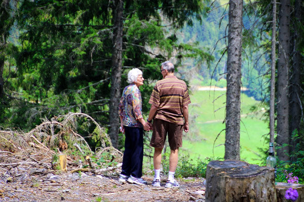 the benefits of blackstrap molasses what is blackstrap molasses elderly couple on a walk hike in the woods on a trail valley view in the background