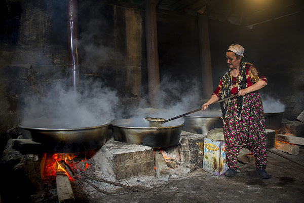 the benefits of blackstrap molasses what is blackstrap molasses elderly woman filtering stirring producing molasses on wood fires traditional