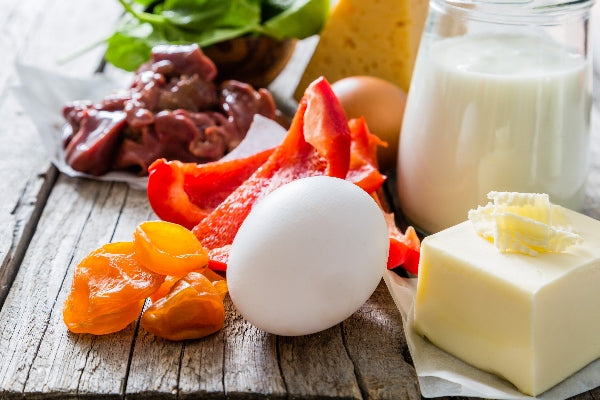 Vitamin A for Immune System Boost foods with vitamin a peppers eggs milk butter cheese on wood table