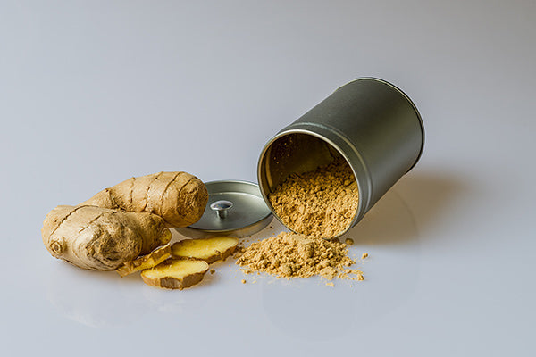 what is inflammation the causes of inflammation natural remedies for inflammation ginger root and powder in metal spice jar spilled over on white table zoomed in