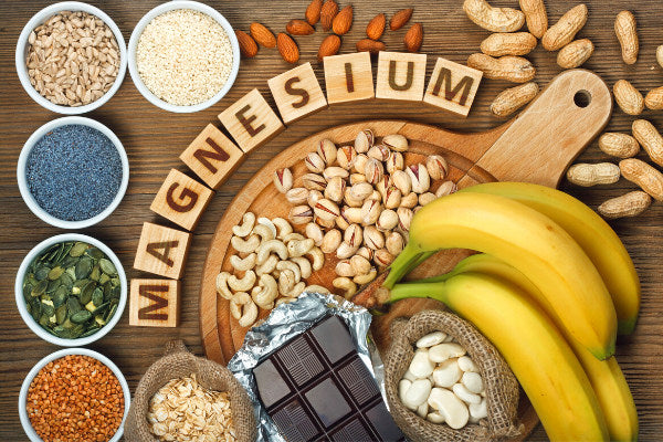 does magnesium help with nerve pain foods with magnesium on wooden table bananas almonds peanuts cashews