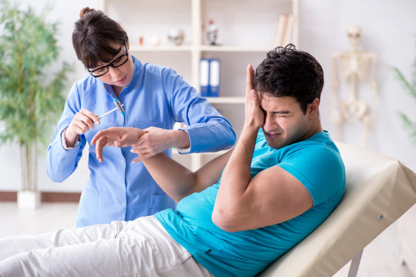 does magnesium help with nerve pain man suffering from neuropathy in wrist getting examination