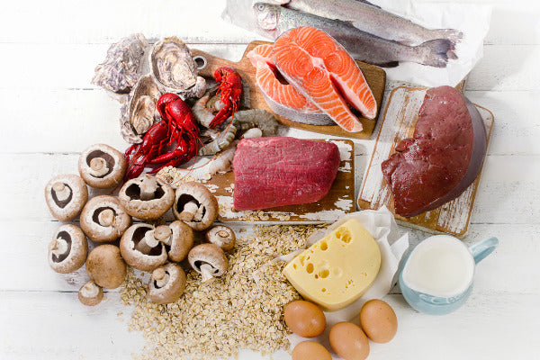 does vitamin b12 boost immune system function foods with vitamin b 12 mushrooms oats crayfish oysters shrimp seafood cheese eggs liver sitting on white wood table