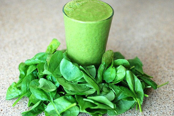 dose of magnesium for muscle cramps does magnesium help cramps in legs spinach smoothie with spinach around the glass on stone table close up