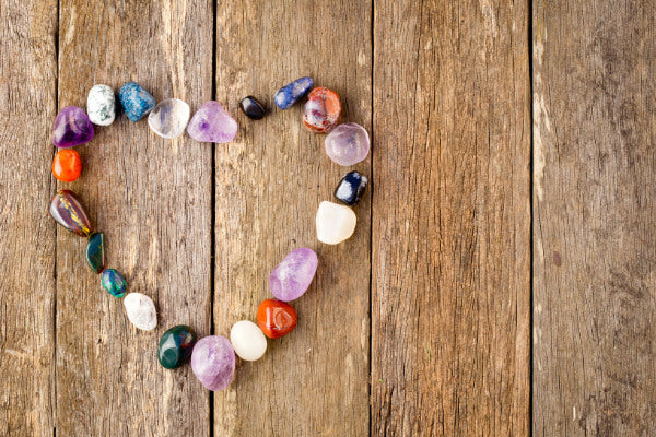 how do healing crystals work crystals in the shape of a heart on wooden table
