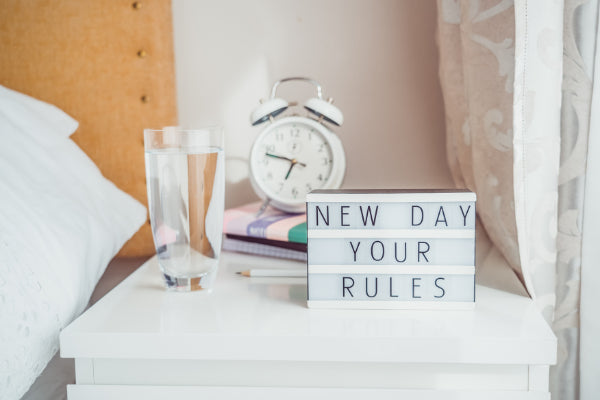 positive affirmations to say everyday influence of affirmations sign close up on bedside table
