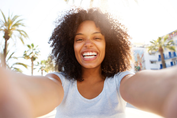 positive affirmations to say everyday woman smiling in selfie outside affirmations for happiness