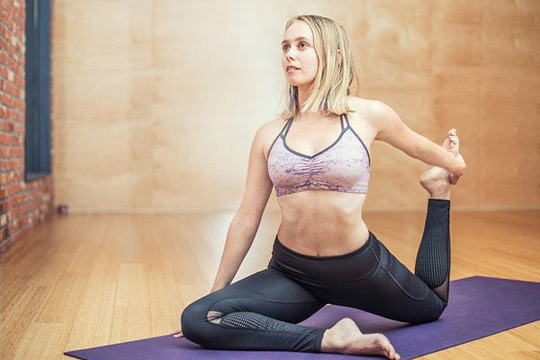 range of motion suffering how to increase range of motion naturally woman in gray and pink on doing yoga pose stretching in studio