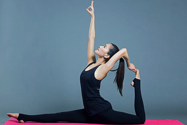 range of motion suffering how to increase range of motion naturally woman wearing all black doing yoga pose stretching