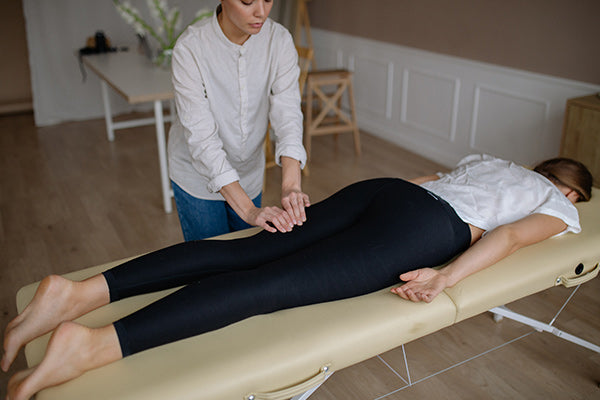 recovering from surgery natural remedies to relieve pain after surgery woman getting a massage to relieve post op operative pain laying face down on table