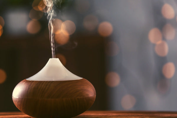 the benefits of an essential oil diffuser wood diffuser on table close up blurred background how to clean