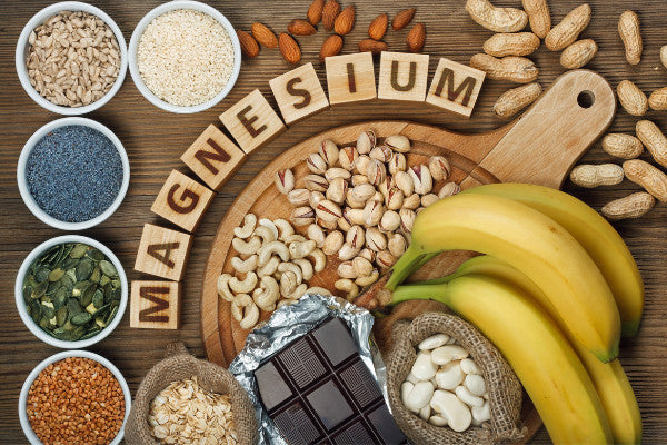the best different types of magnesium fruits nuts foods with magnesium wooden blocks spelling magnesium close up