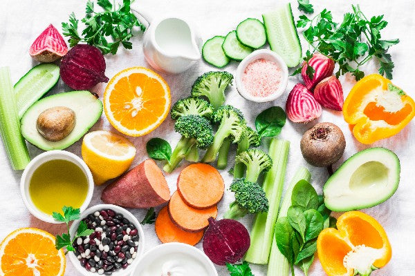 Vitamin C For Immune System Healthy Fruits and Vegetables Spread on White Background