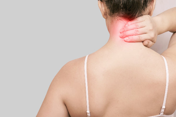 what is occipital neuralgia occipital neuralgia causes symptoms and treatments for occipital neuralgia woman in white tank top holding back of neck
