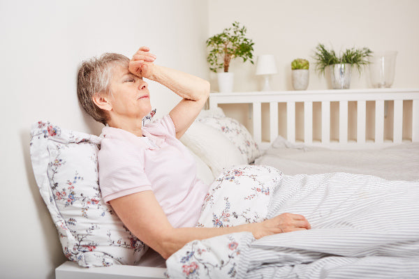 what is vasculitis causes symptoms of vasculitis what natural treatment for vasculitis may help elderly woman laying in bed flowered bed set exhausted from vasculitis