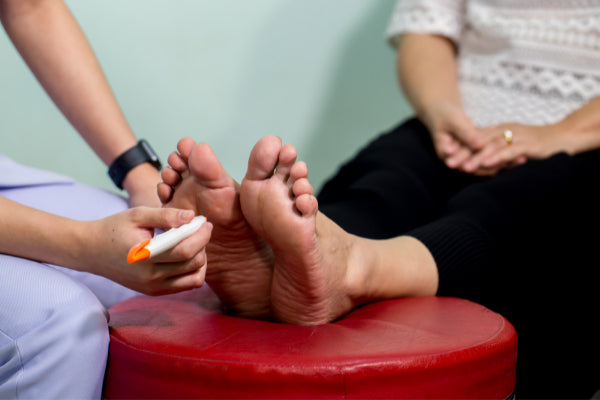 whats diabetic neuropathy natural remedies to help person getting feet looked at for symptoms
