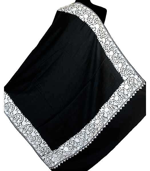 Black and white embroidered throw.