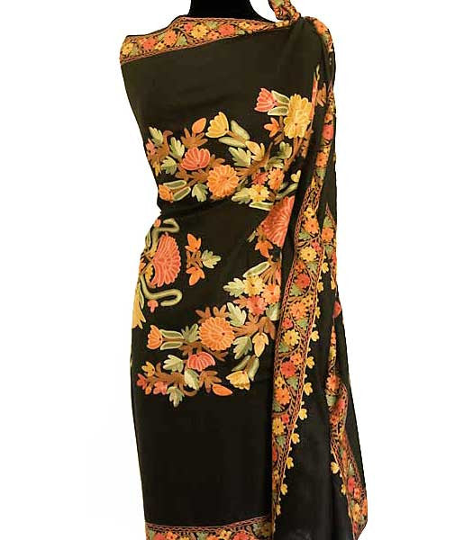 Colorful shawl embroidered flowers on a large, black wool shawl.