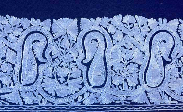 Shawl embroidered with paisleys.