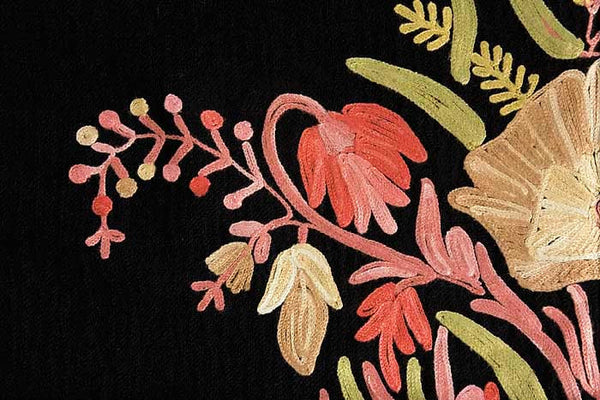 Flowers embroidered on to a black wool shawl