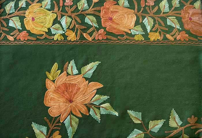 Embroidered flower on shawl.