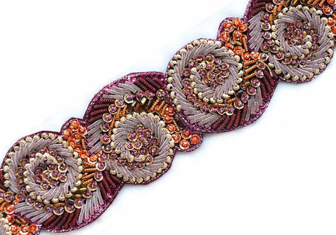 hand beaded sewing trim from India on a burgundy background