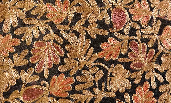 Gold, red and tan embroidery on a black Indian shawl.