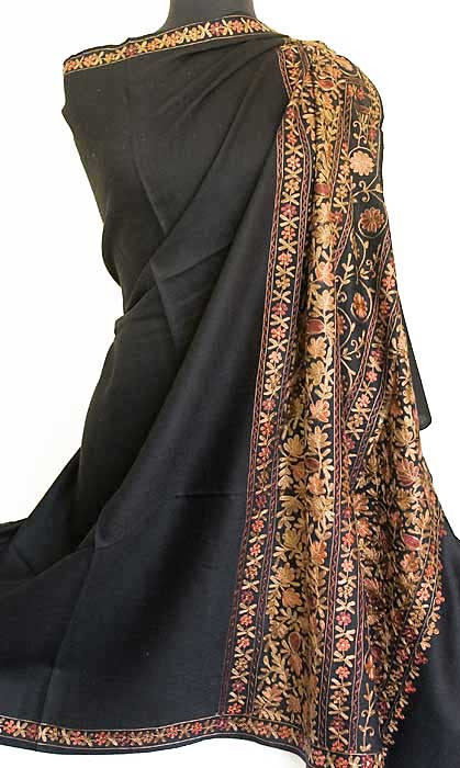 Black wool shawl with red and tan embroidery.