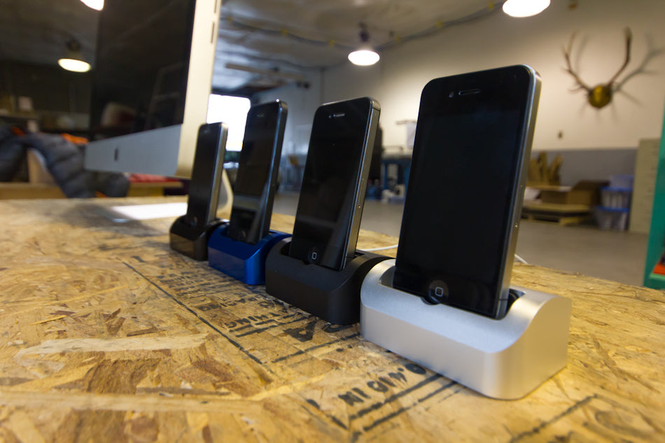 Row of Elevation Docks with iPhones in the warehouse