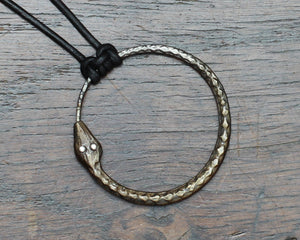 Iron Ouroboros Pendant with silver eyes