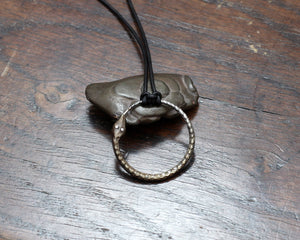 Forged iron Ouroboros pendant with silver eyes